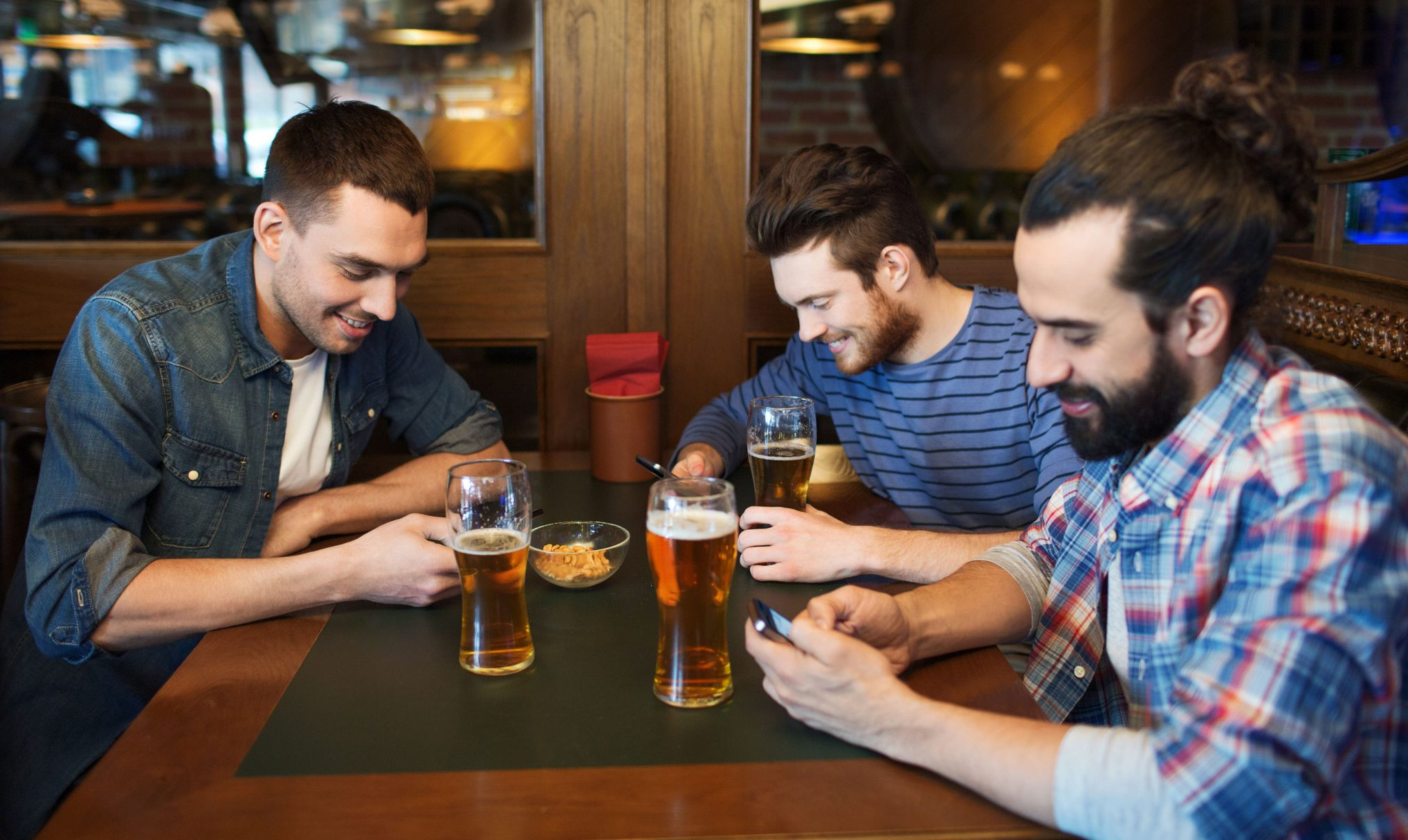 three men at pub