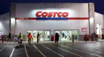 costco storefront lit at dusk