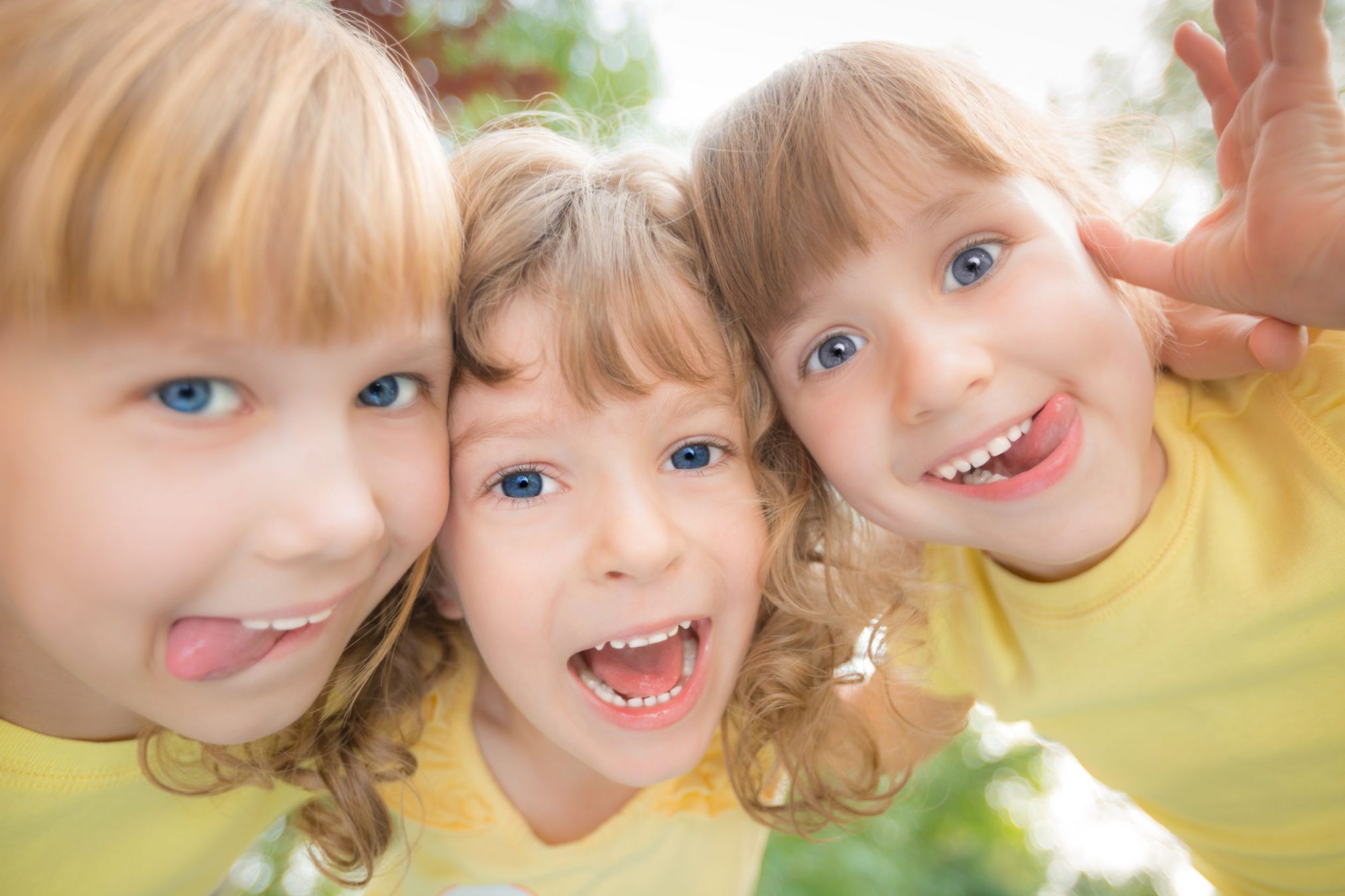 three girls playing and pulling silly faces
