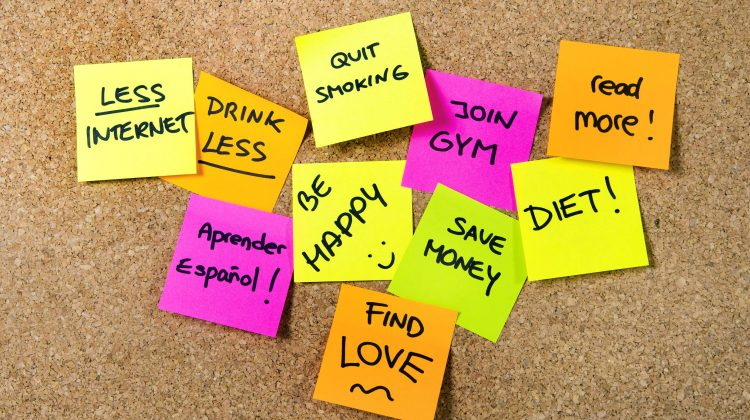 32657850 - group of new year resolutions post it notes on pink, yellow, orange and green on cork board written with message of diet, join gym, find love, quit smoking and be happy
