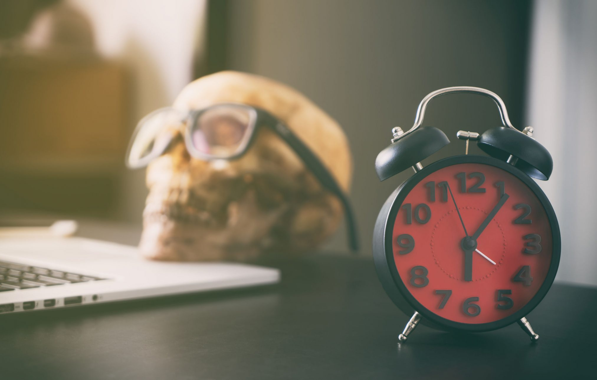 red clock and skull