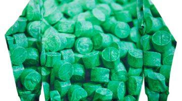 green shirt with pill motif