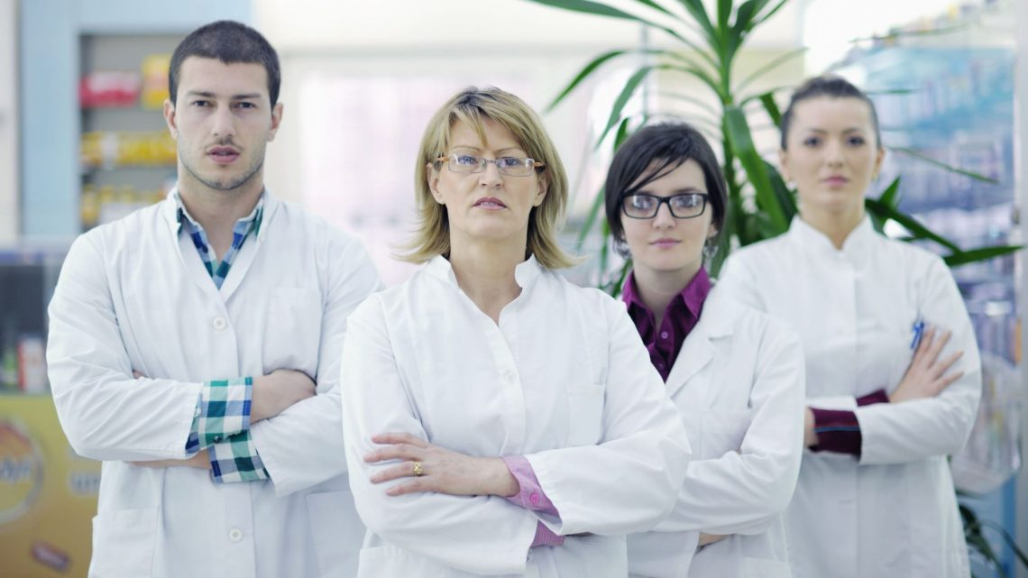 four unfriendly-looking pharmacists
