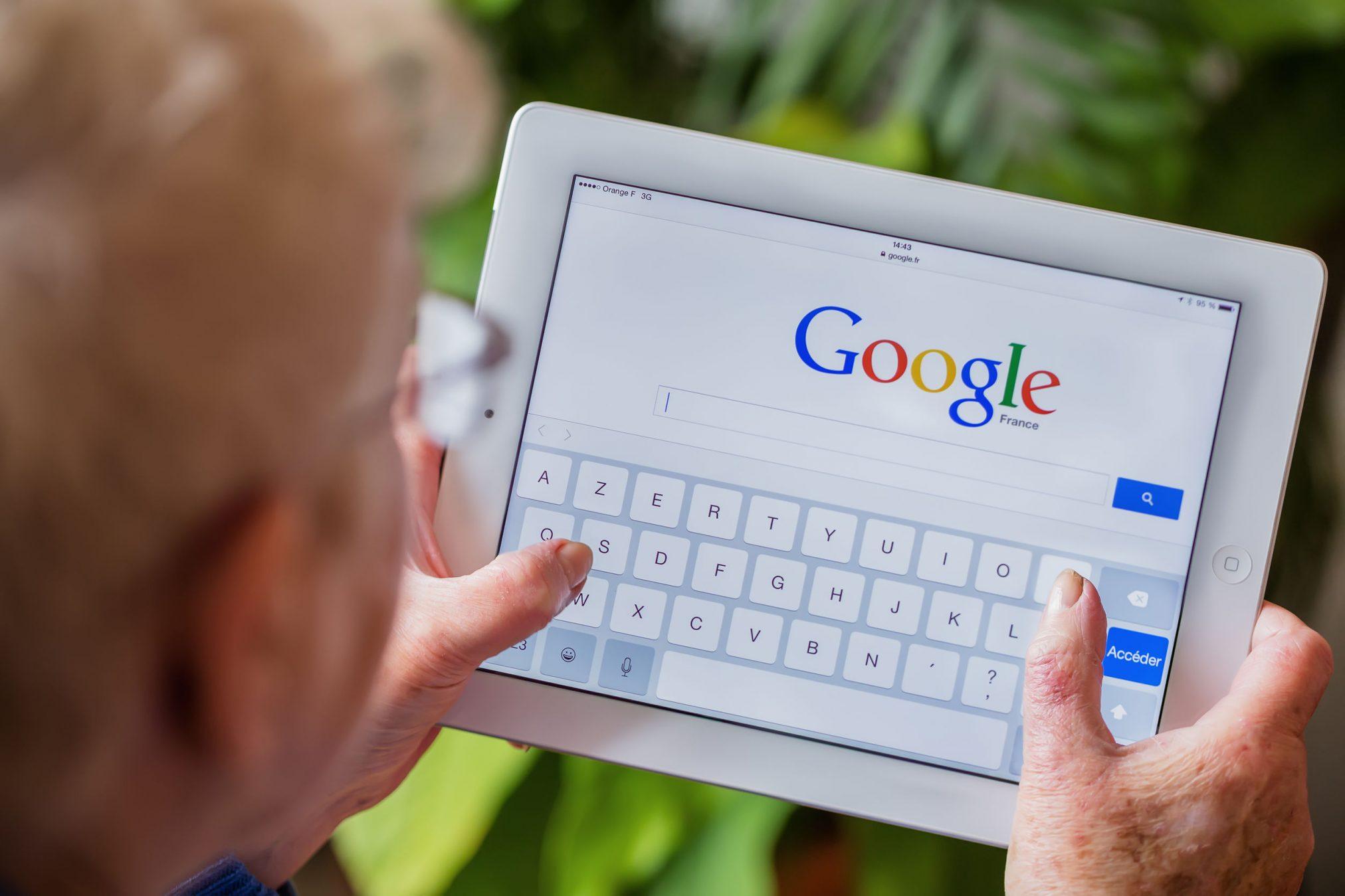 senior woman googling on tablet