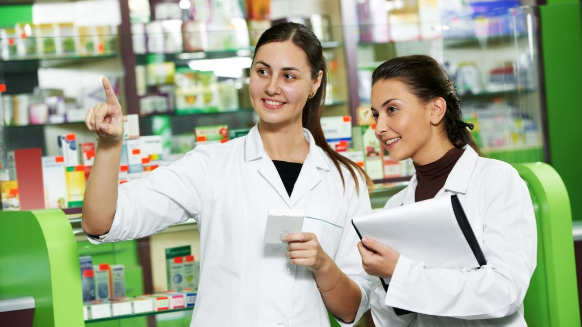 Pharmacy assistants talking