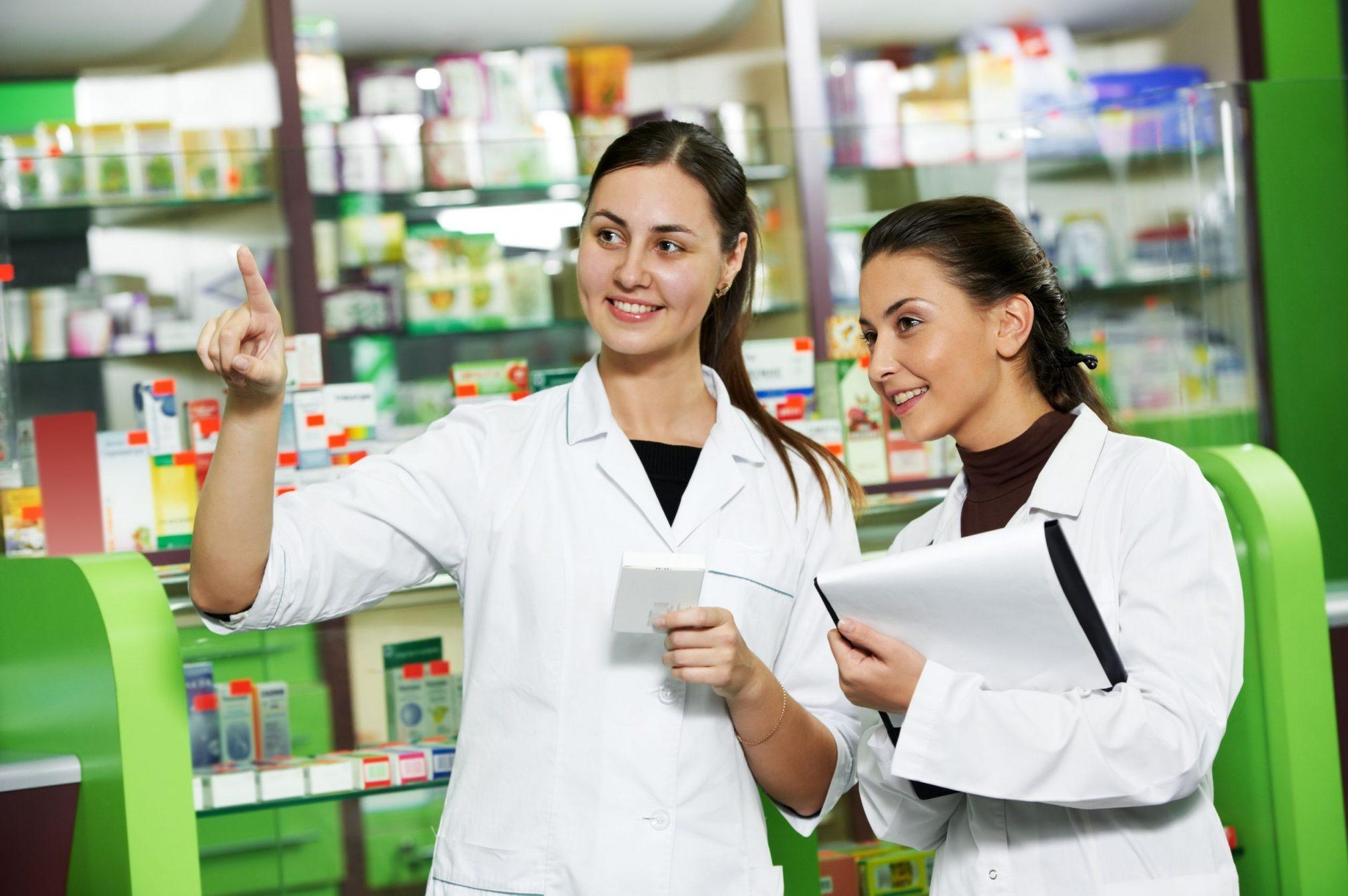 Pharmacy assistants talking