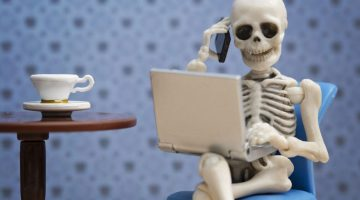 skeleton with laptop and phone