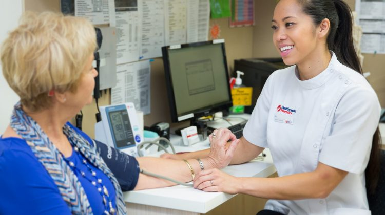 Female Pharmacist and Female Customer Consult Room Blood Pressure_4