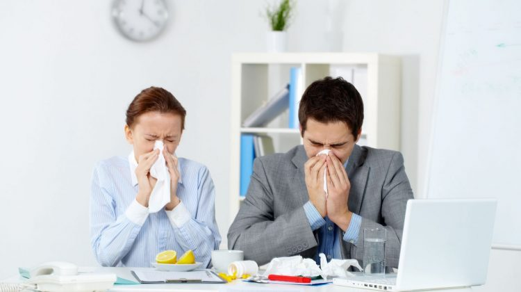 office workers blowing noses