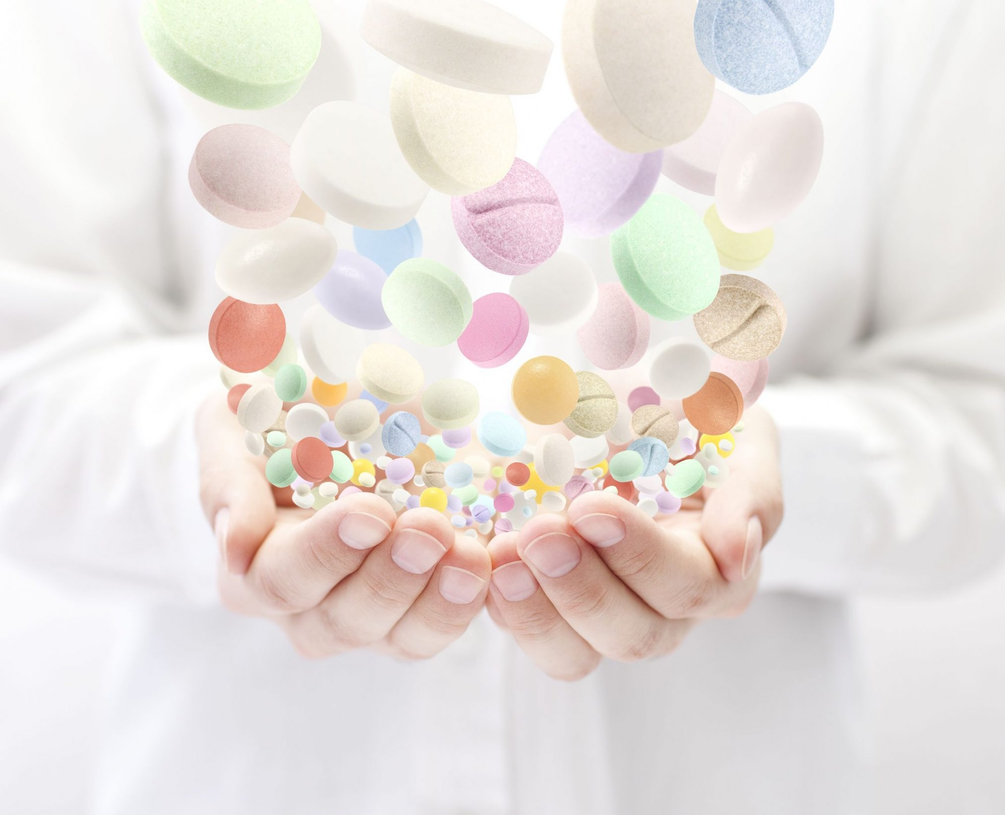 Pills falling into pharmacist's hands