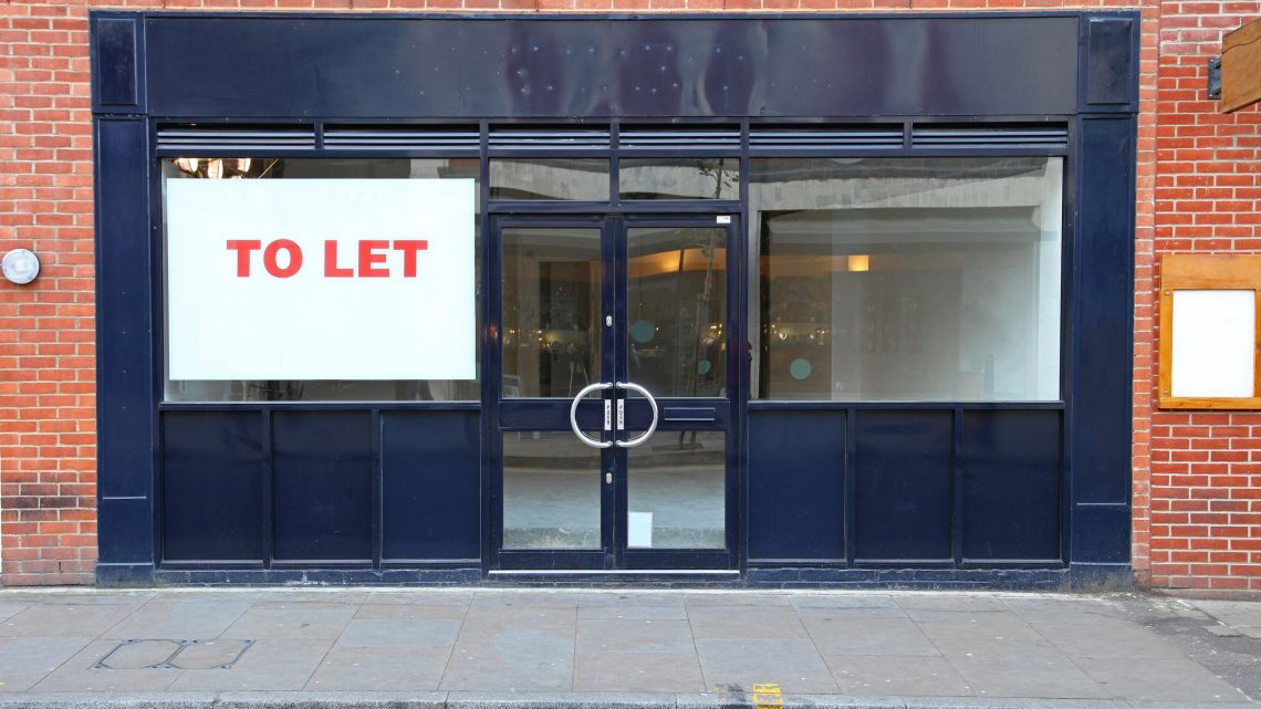 empty shop with to let sign