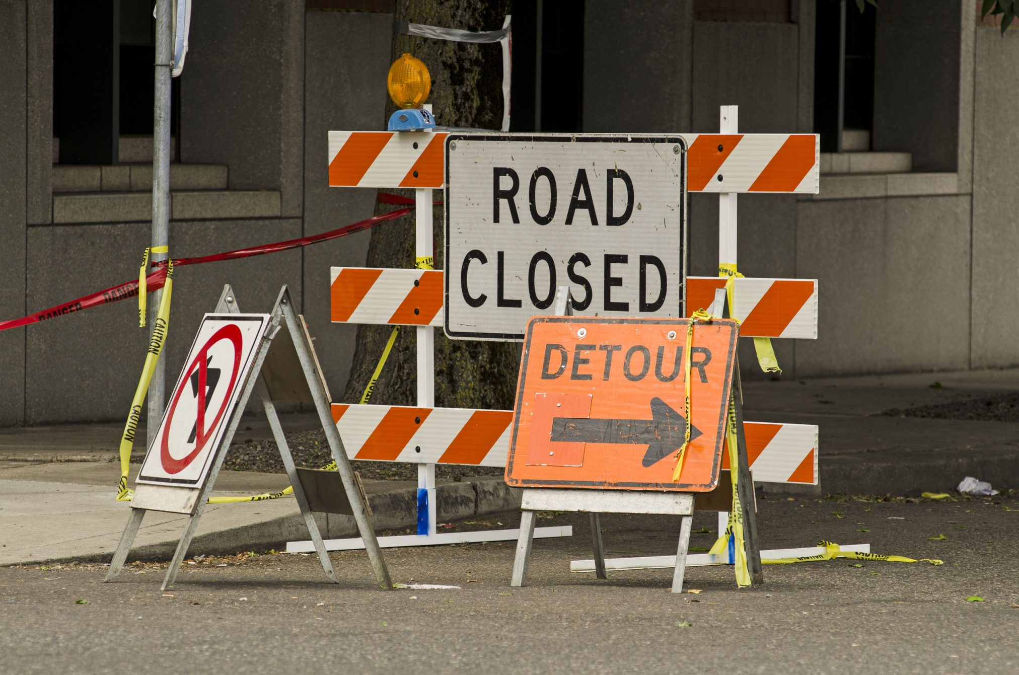 Detour and roadblock signs