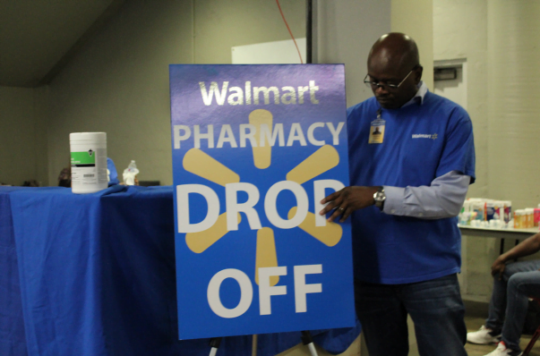 man readies the Walmart pop-up pharmacy