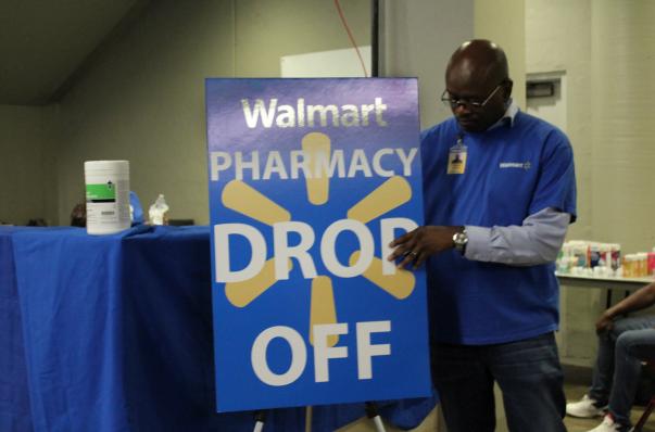 man readies the Walmart pop-up pharmacy