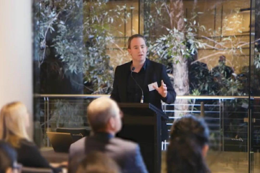Luke McKinnon presents at a Symbion forum.