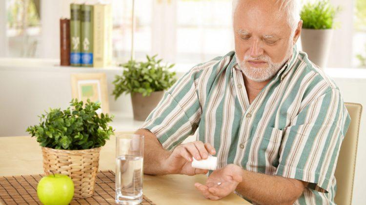 elderly man older man taking pill medicine medication viagra ED drug sildenafil