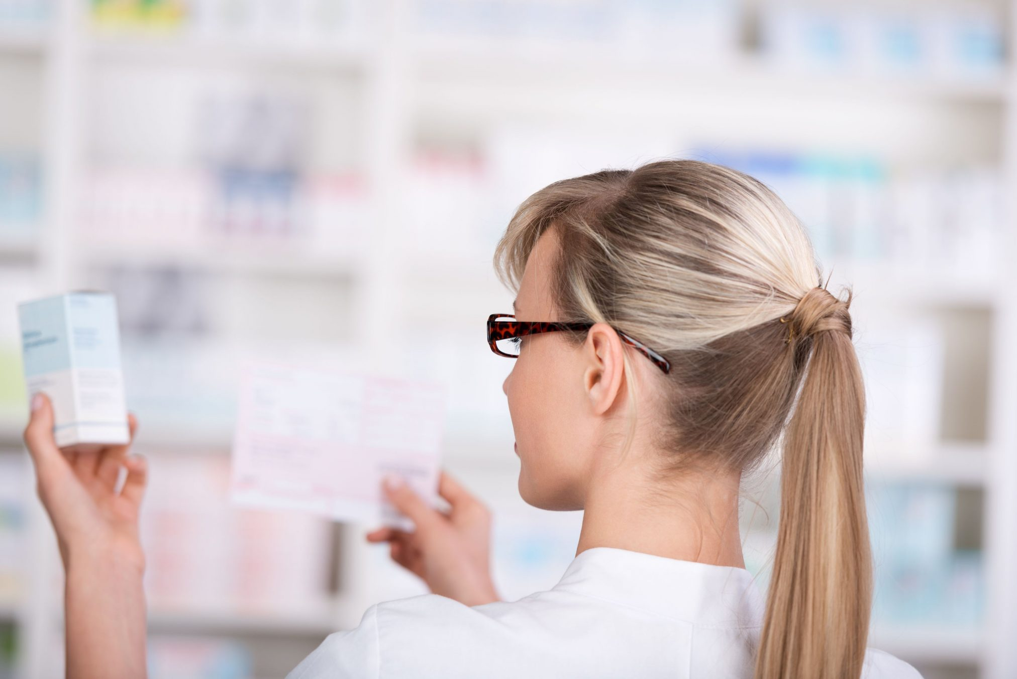 female pharmacist prescription script dispensary