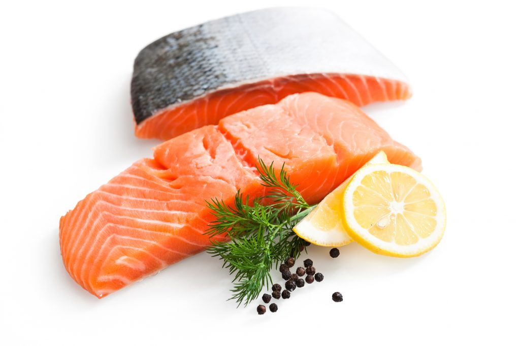 Fresh salmon with parsley and lemon slices