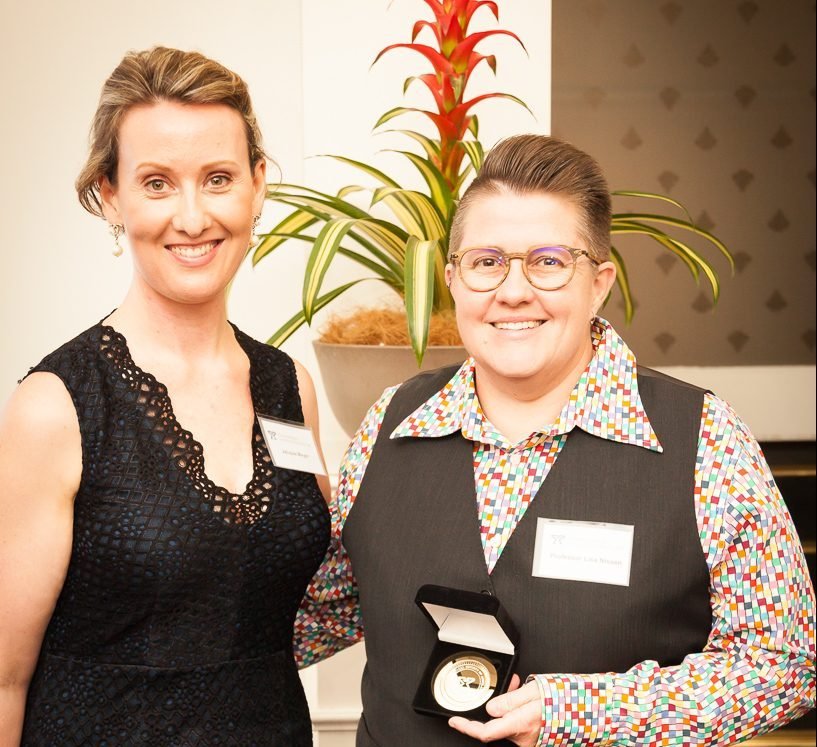 Prof Lisa Nissen FPS receives the PSA QLD Gold Medal Award from Queensland Branch President Jacqueline Meyer.