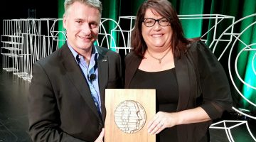 Professor Michael Dooley and Dr Danielle Stowasser with her award.