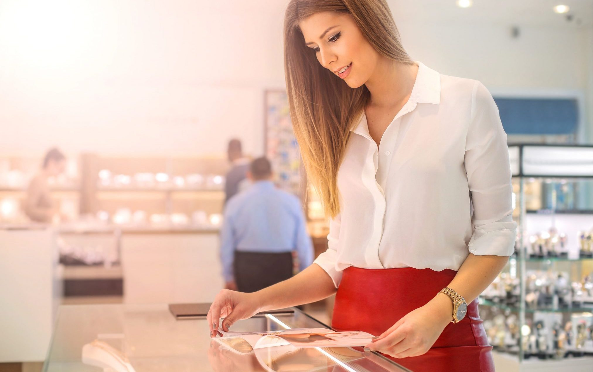 woman reading catalogue magazine