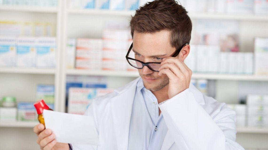 pharmacist double checking prescription