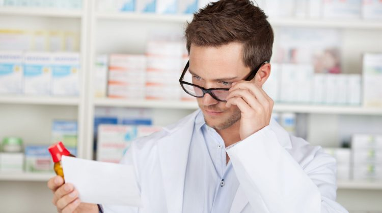 pharmacist double checking prescription