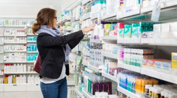 woman shopping in pharmacy products beauty retail personal care
