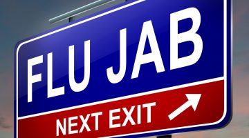 sign that says: 'flu jab next exit'