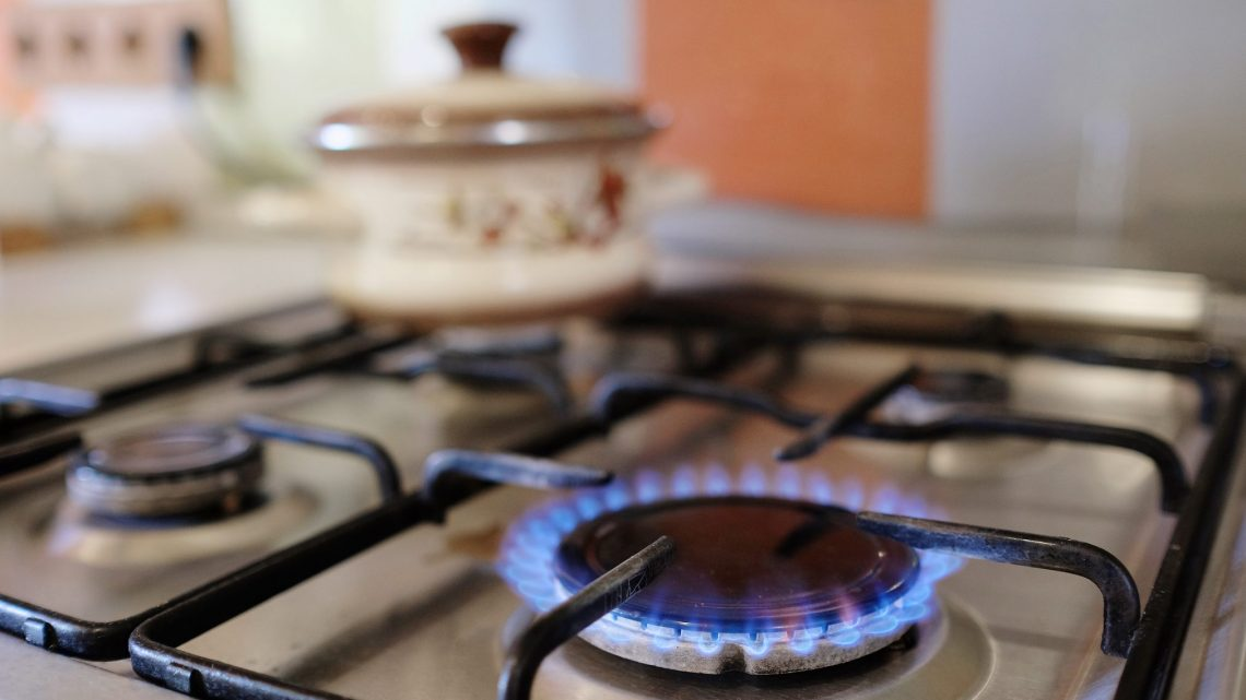 gas burner alight on stove top