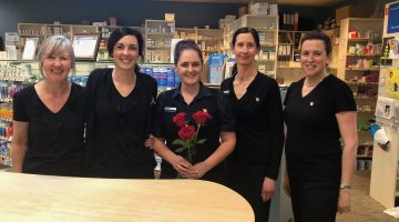 Bellerive Quay Guardian pharmacy donated to 65 Roses. Staff with roses