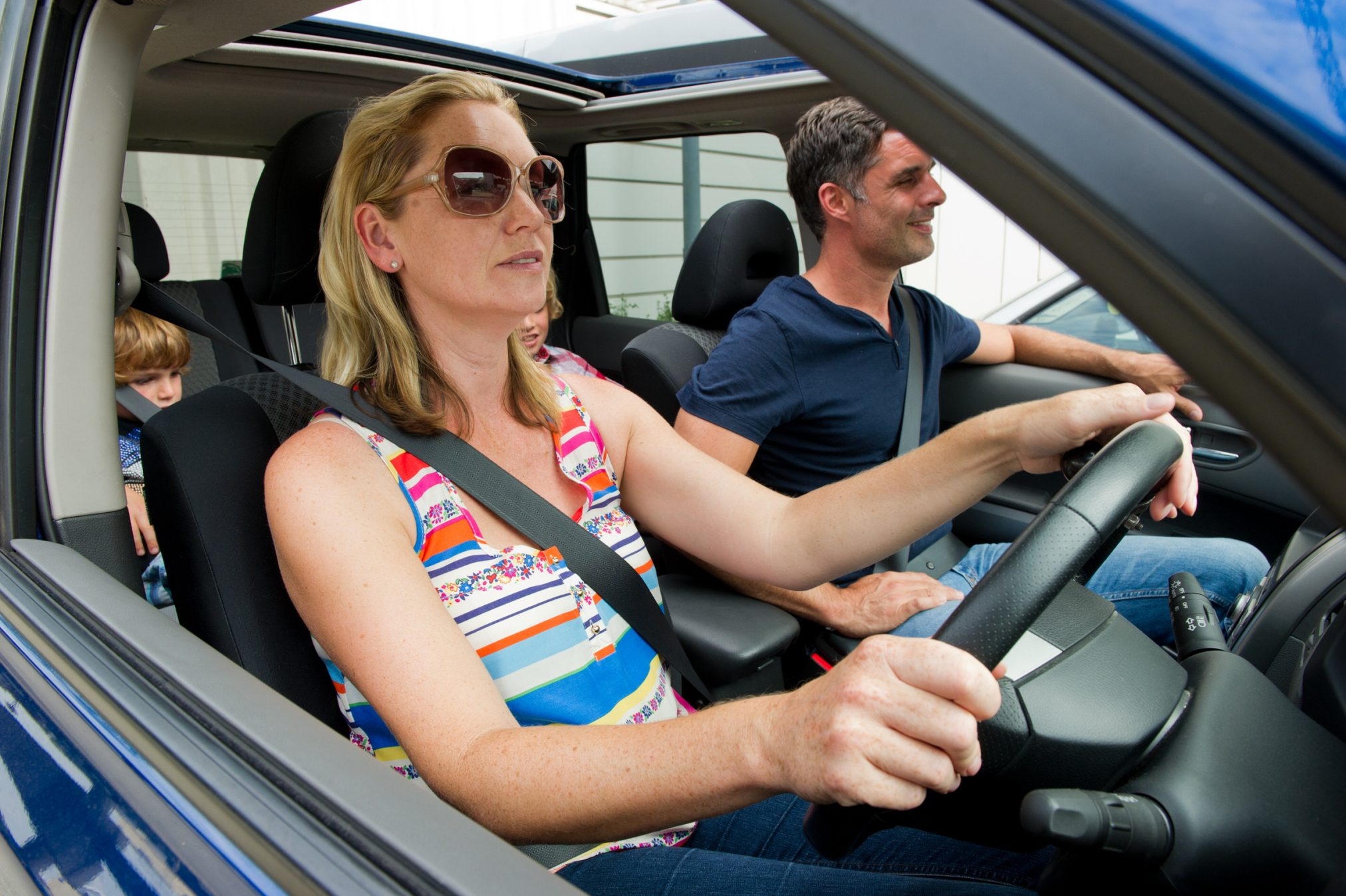 parents kids in car drive through Credit: Professional Images