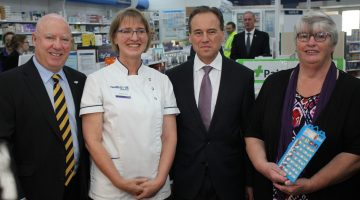 Guild Tas Branch President John Dowling, pharmacist Heather Wild, Health Minister Greg Hunt, and patient Wendy Donoghue who uses Dose Administration Aids