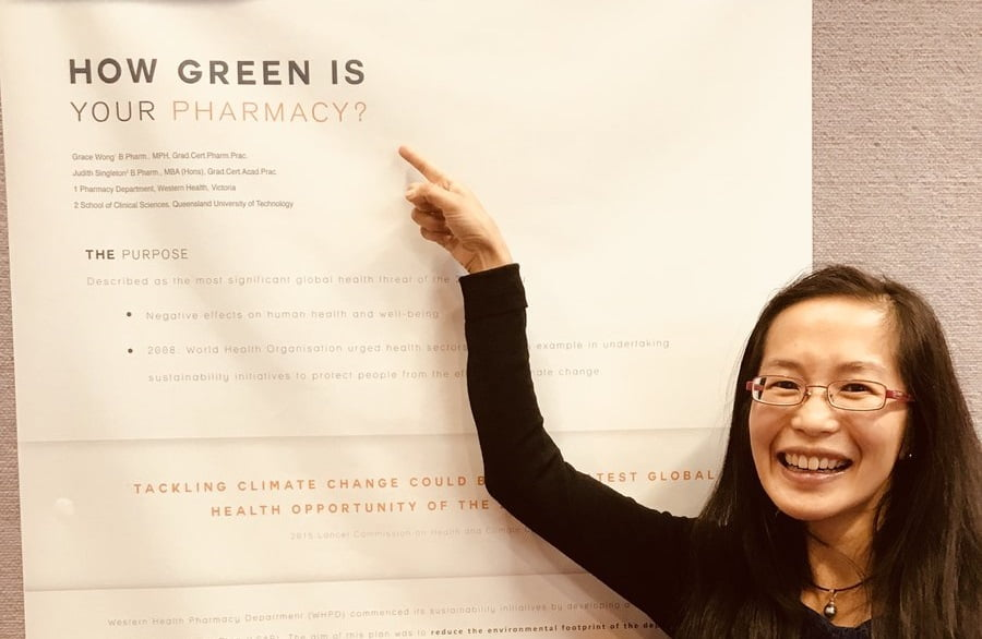 Grace Wong with her winning poster. Credit: Allan Nash