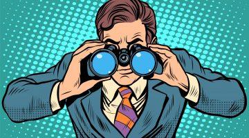 man with binoculars searching