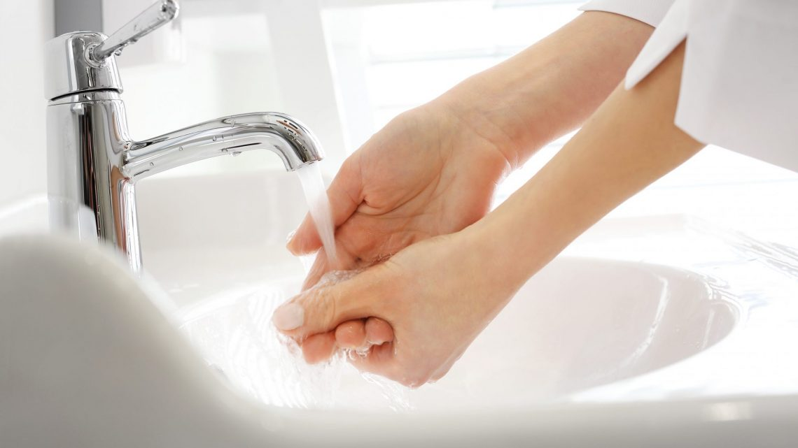 health professional washing hands