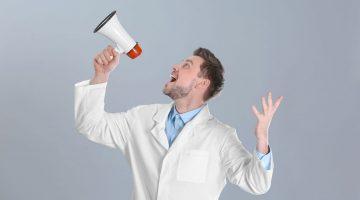 white coat professional shouting into megaphone