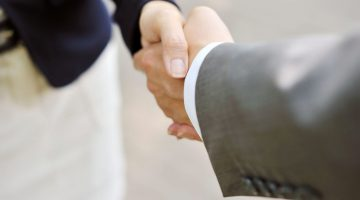shaking hands handshake business deal partnership