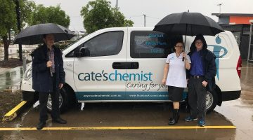 Cate's Chemist staff brave the wet to go to work. Image: Cate's Chemist via Facebook.