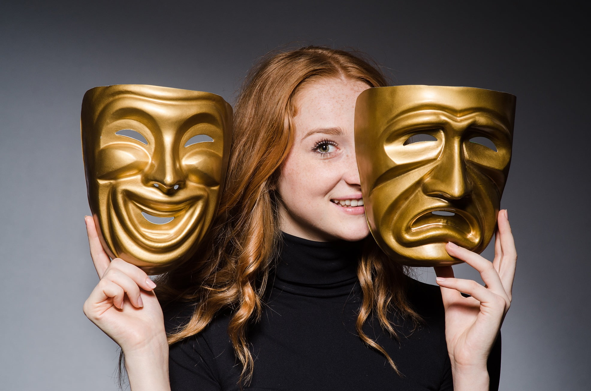 redhead woman with two theatre masks - comedy and tragedy