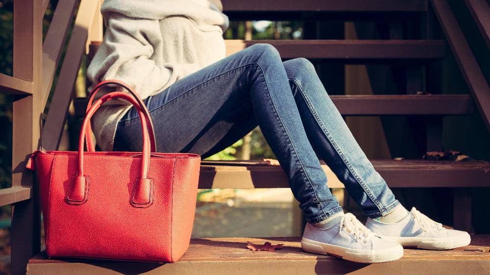 woman with large red handbag