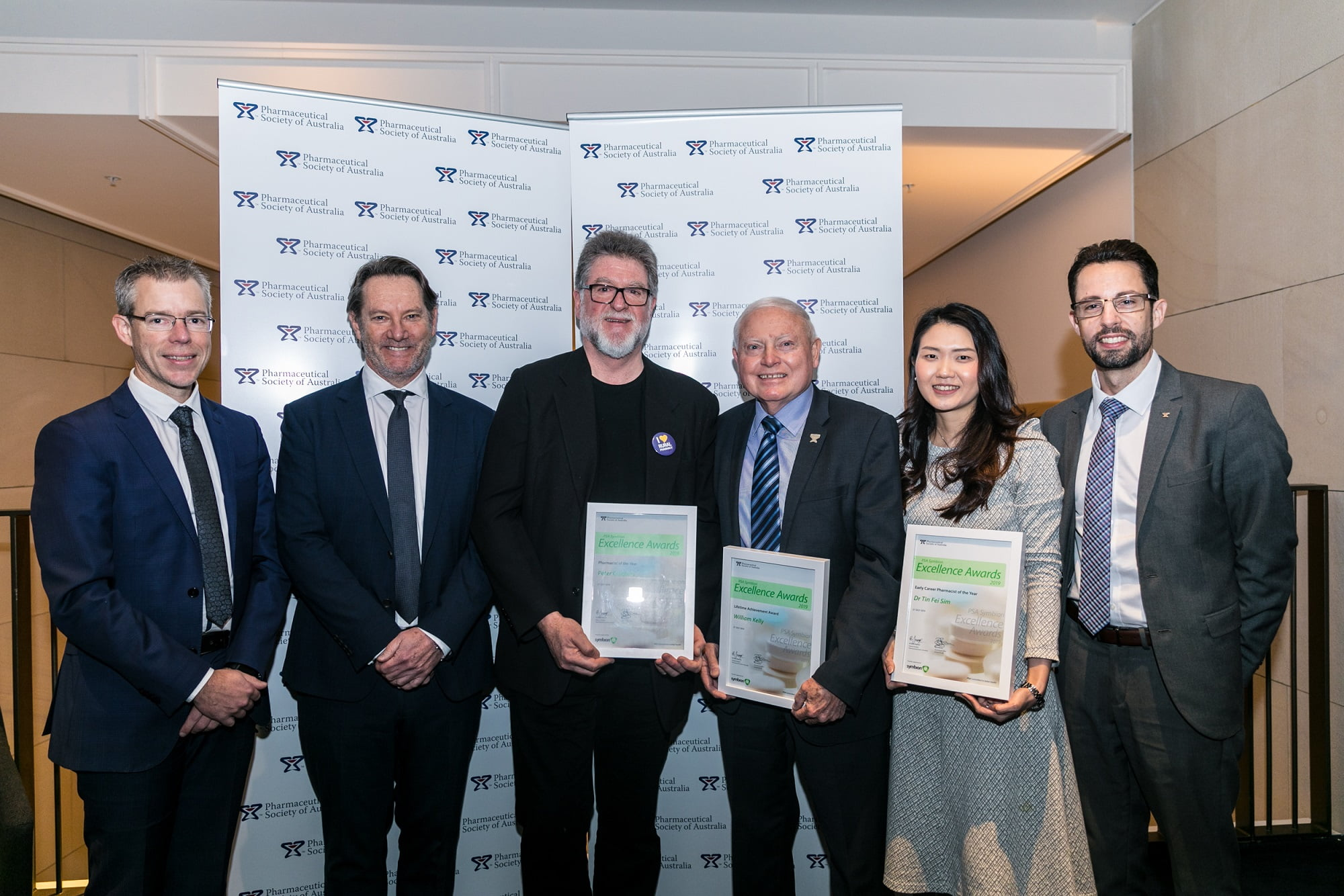 PSA CEO Dr Shane Jackson, Symbion General Manager Strategic Groups Mr David Beaton; Pharmacist of the Year Mr Peter Crothers; Lifetime Achievement Award winner Col. (Rtd) Bill Kelly; Early Career Pharmacist of the Year Dr Fei Sim; and PSA National President Dr Chris Freeman