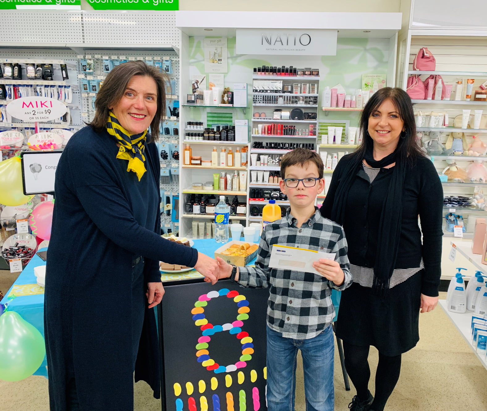 Presentation at Kings Meadows Discount Pharmacy, Launceston. Left to right: Pharmacy Guild National Councillor Helen O'Byrne , Carter Lithgow, Leanne Fulcher Retail Manager.
