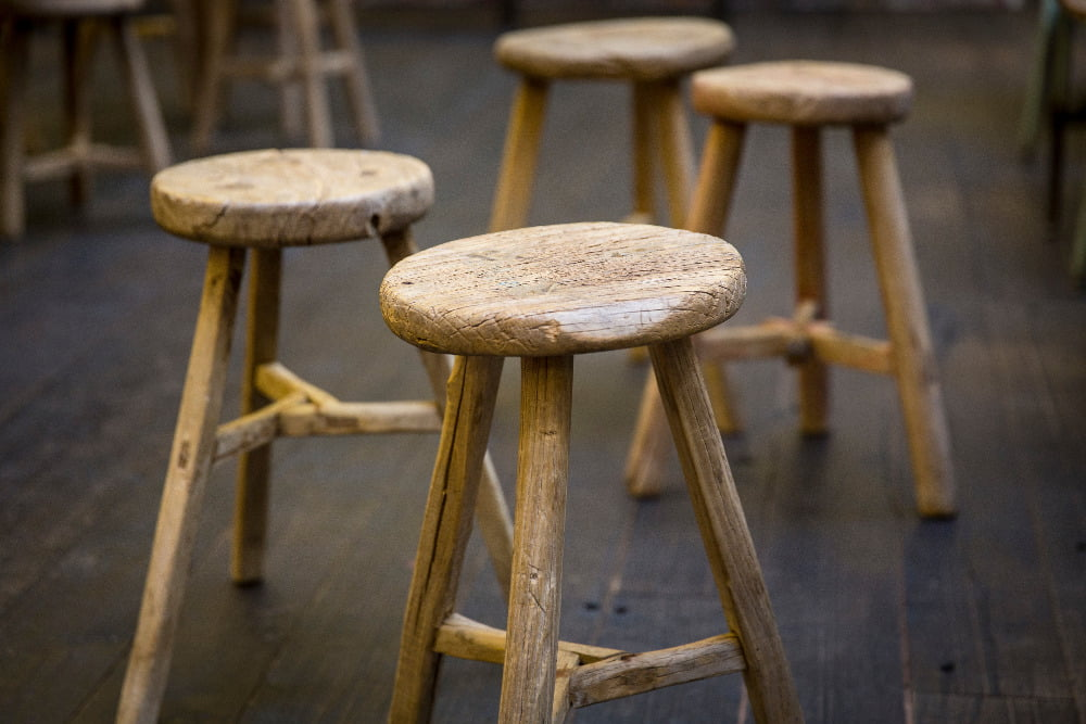 three-legged wooden stools