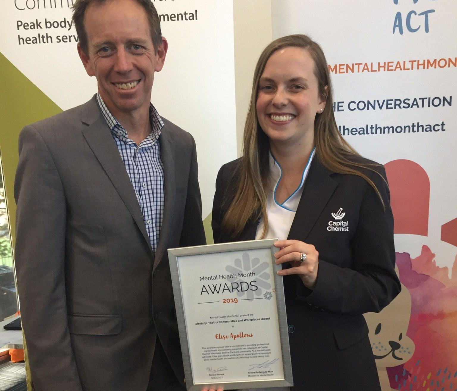 Shane Rattenbury presents Elise Apolloni with her ACT Mental Health Award.