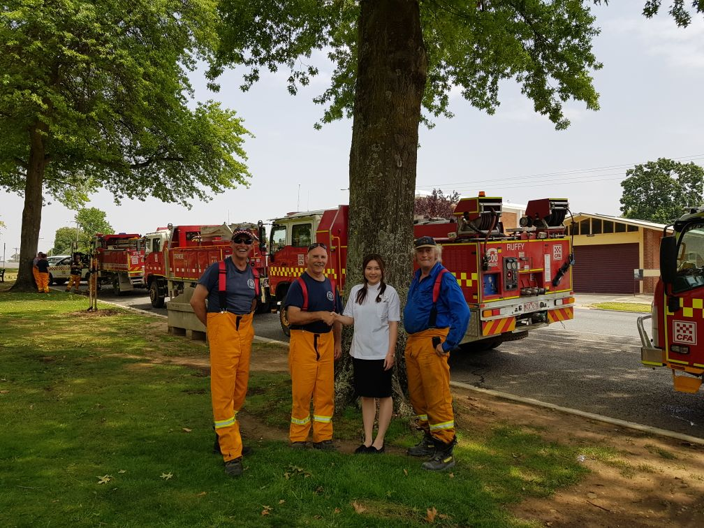 Helen Feng, owner of the Alliance Pharmacy Tallangatta, meets local CFA crew members.