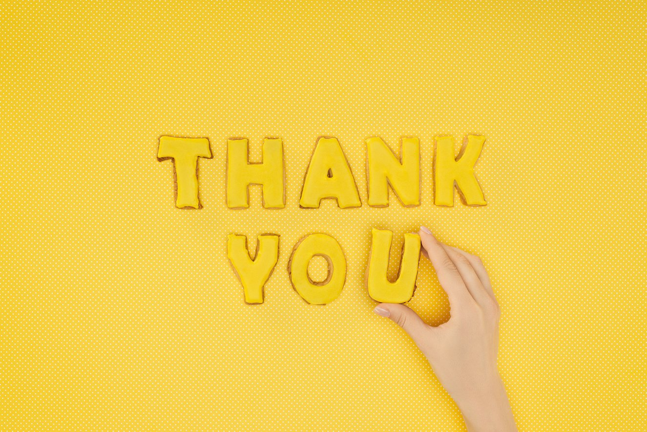 yellow background, thank you in letters