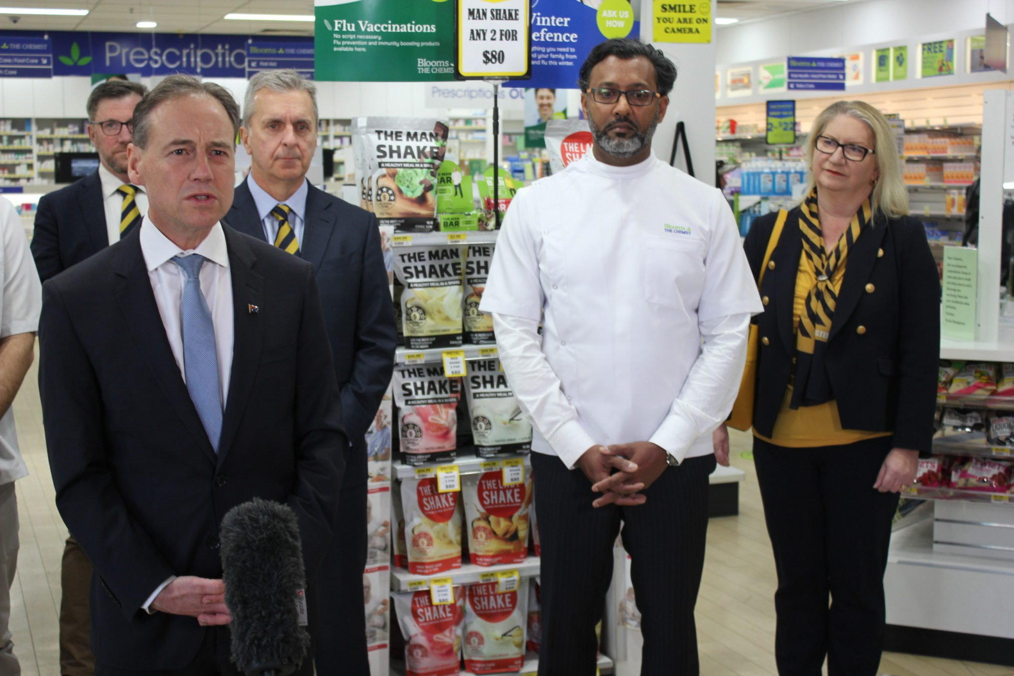 Pharmacy Guild NSW president David Heffernan, Health Minister Greg Hunt, Guild national president George Tambassis, Blooms pharmacy Karabar owner Mohammad Hasan, Guild executive director Suzanne Greenwood