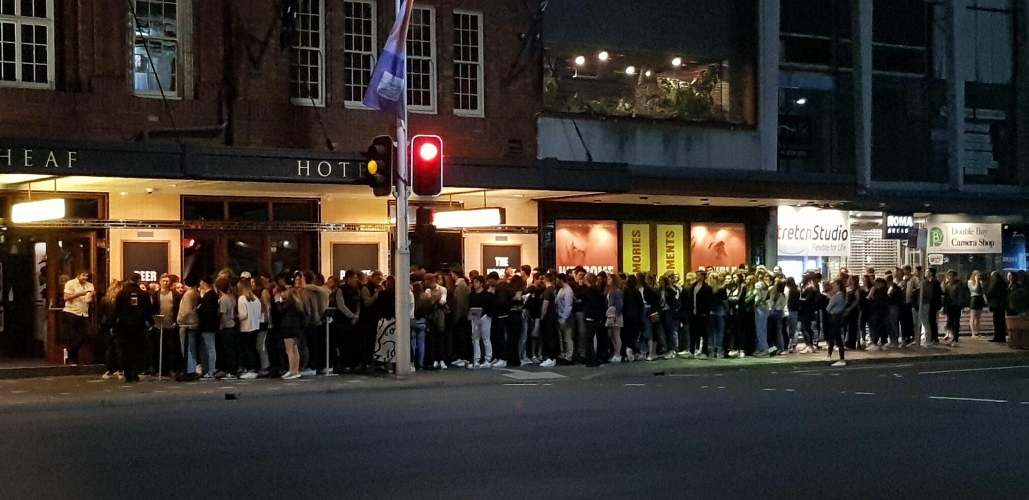 Patrons line up outside the Golden Sheaf hotel. Image: Reddit