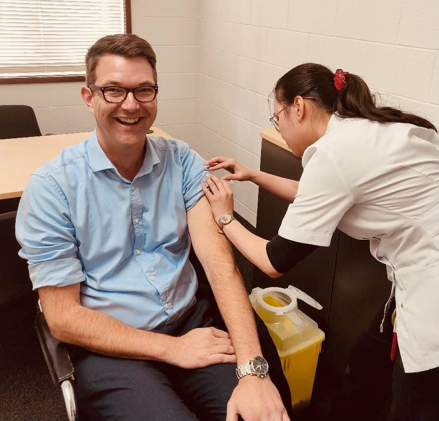 Bastien Seidel receives his flu shot from pharmacist Sandy at Healthsave Youngtown Pharmacy. Image via Facebook.